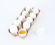 Eggs. 10 eggs and one cracked on white stock photos