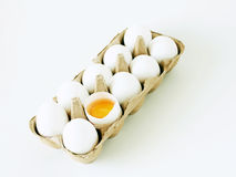 Eggs. 10 eggs and one cracked on white stock image