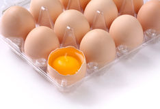 Eggs. With broken egg in plastic box Stock Image