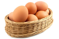 Eggs. Brown eggs in a Wicker basket on a white background Stock Images