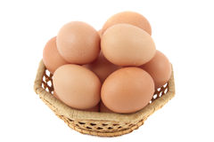 Eggs. Some eggs in a wattled basket. It is isolated on a white background Royalty Free Stock Images