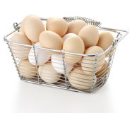 Eggs. In wire basket on white background Stock Photos