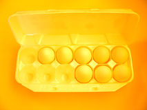 Eggs 2. A carton of eggs from the top. Extreme yellow/orange coloring Royalty Free Stock Images