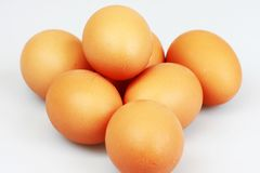 Eggs. Pile of eggs on white background Royalty Free Stock Photos