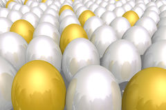 Eggs. Some golden eggs between many white ones Stock Photo
