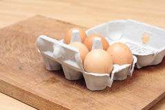 Eggs. Fresh hens eggs in an eggbox Stock Photography