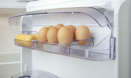Eggs. In the fridge box stock images