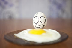 Eggs. Living and emotional eggs, different situation royalty free stock photo