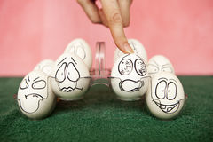 Eggs. Living and emotional eggs, different situation stock image