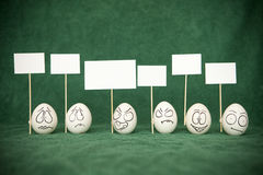 Eggs. Living and emotional eggs, different situation stock photos