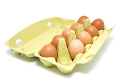 Eggs. In a carton basket, one missing egg, isolated Stock Images
