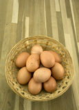Eggs. Speckled free range eggs in a rustic basket Stock Image