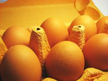 Eggs 3. A carton box of eggs. Yellow surface and grey highlights stock image