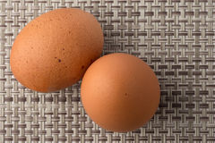 Eggs. Two eggs on patterned background royalty free stock photo