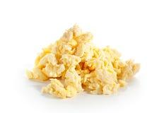 предпосылка eggs белизна вскарабканная омлетом Стоковая Фотография RF