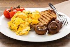 предпосылка eggs белизна вскарабканная омлетом Стоковые Фото