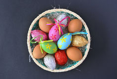 Eggs. Basket with fresh and Easter eggs over bule Stock Photography