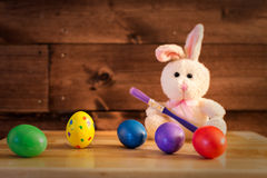 The Eggs Already Painted. An Ester Rabbit painting the eggs Royalty Free Stock Image