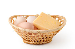 Eggs And Cheese Lay In A Woven Basket Stock Photo