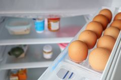 Eggs arrange on refrigerator. Shelf royalty free stock images