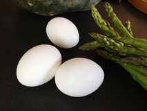 Eggs. Asparagus and eggs for breakfast cooking Stock Image