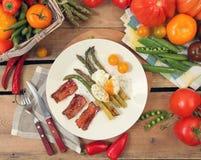 Eggs with asparagus Stock Photos
