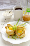 Breakfast: Toasted Eggs And Ramson. Eggs backed in toasts, with cress And Ramson. White cup of tea, orange muffin and chinese sugar in sugar pot, two empty Stock Photos