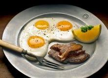 Eggs bacon. Eggs with bacon on metal plate Stock Photos