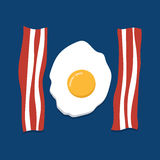 Eggs and bacon on blue background Royalty Free Stock Image
