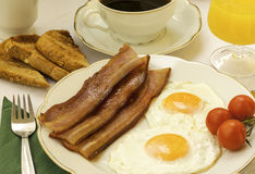 Eggs and bacon for breakfast. Homemade breakfast, eggs,bacon and toast t Royalty Free Stock Images