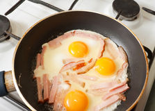 Eggs and bacon on hot skillet Stock Image