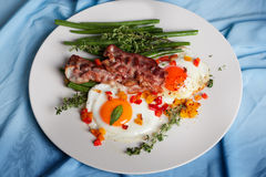 Eggs with bacon, peppers, green beans and thyme Royalty Free Stock Photo