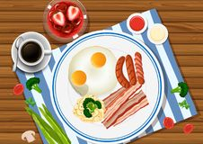 Eggs and bacon on the plate with drinks on the side Stock Photos