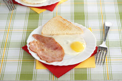 Eggs, bacon and toast. Breakfast with eggs, bacon and toast Royalty Free Stock Images