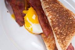 Eggs bacon and toast bread Stock Photos