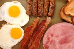 Eggs, Bacon, Toast, Ham. Top view of eggs, bacon, sausage, toast and ham Stock Image
