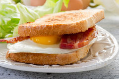 Eggs  bacon and toasted bread Stock Images