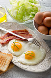 Eggs  bacon and toasted bread Royalty Free Stock Photos