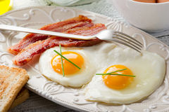 Eggs bacon and toasted bread stock photos