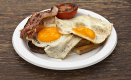 Eggs, Bacon and Tomato on Toast Stock Images