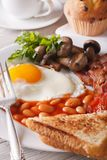Eggs with bacon and vegetables close-up on a plate. Vertical Royalty Free Stock Image