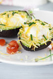 Eggs Baked in Avocado with Cheese Royalty Free Stock Image
