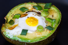 Eggs baked in avocado Stock Photography
