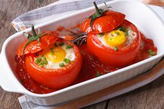 Eggs baked in tomato top view. close up Royalty Free Stock Images