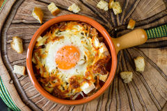 Eggs baked with vegetables and crackers Royalty Free Stock Images