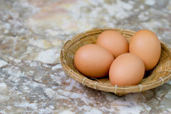 Eggs in bamboo Stock Photo