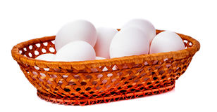 Eggs in bamboo basket on a white background Stock Image