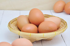 Eggs on bamboo basket. Royalty Free Stock Photography