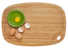 Eggs on bamboo board Royalty Free Stock Photo
