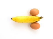 Eggs and banana composing a penis Royalty Free Stock Photo